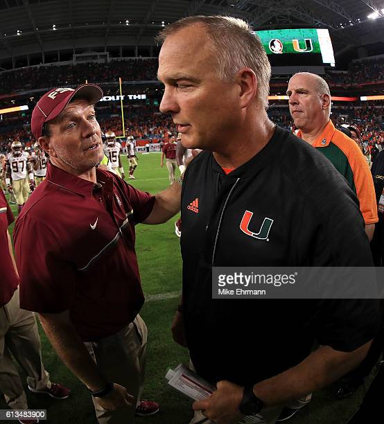 Head coach Jimbo Fisher of the Florida State Seminoles shakes hands with Miami Hurricanes head coach Mark Richt during a game against the Miami...