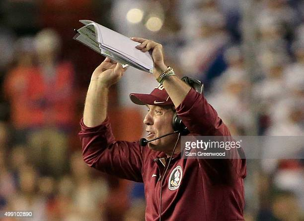 Head coach Jimbo Fisher of the Florida State Seminoles signals to his players during the game against the Florida Gators at Ben Hill Griffin Stadium...