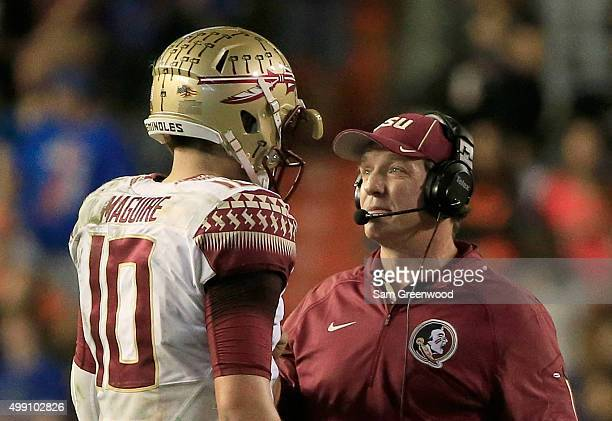 Head coach Jimbo Fisher of the Florida State Seminoles speaks with Sean Maguire during the game against the Florida Gators at Ben Hill Griffin...