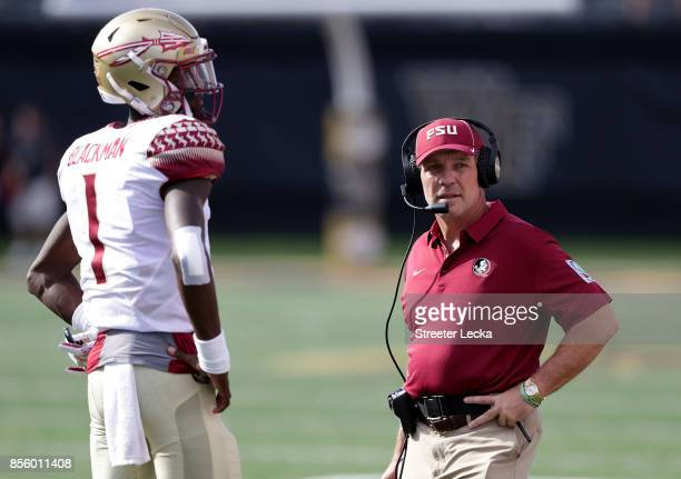 Head coach Jimbo Fisher of the Florida State Seminoles stands with his quarterback James Blackman against the Wake Forest Demon Deacons during their...