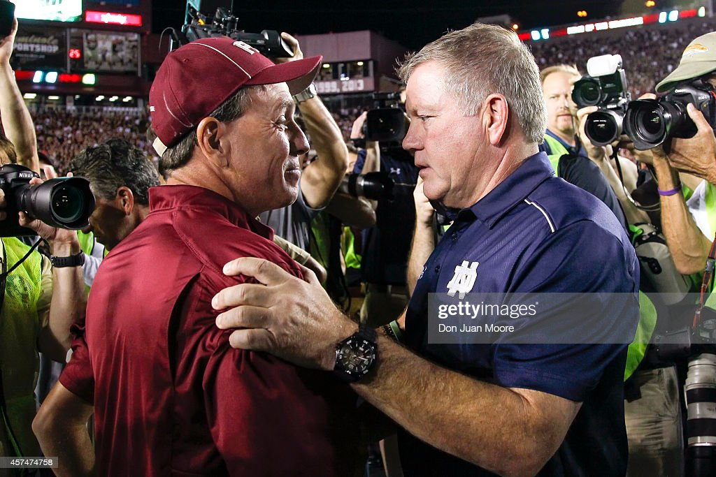 Head Coach Jimbo Fisher of the Florida State Seminoles talk with Head Coach Brian Kelly of the Notre Dame Fighting Irish before the game at Doak Campbell Stadium on Bobby Bowden Field on October 18, 2014 in Tallahassee, Florida. The #2 ranked Florida State Seminoles defeated the #5 ranked Notre Dame Fighting Irish 31 to 27.