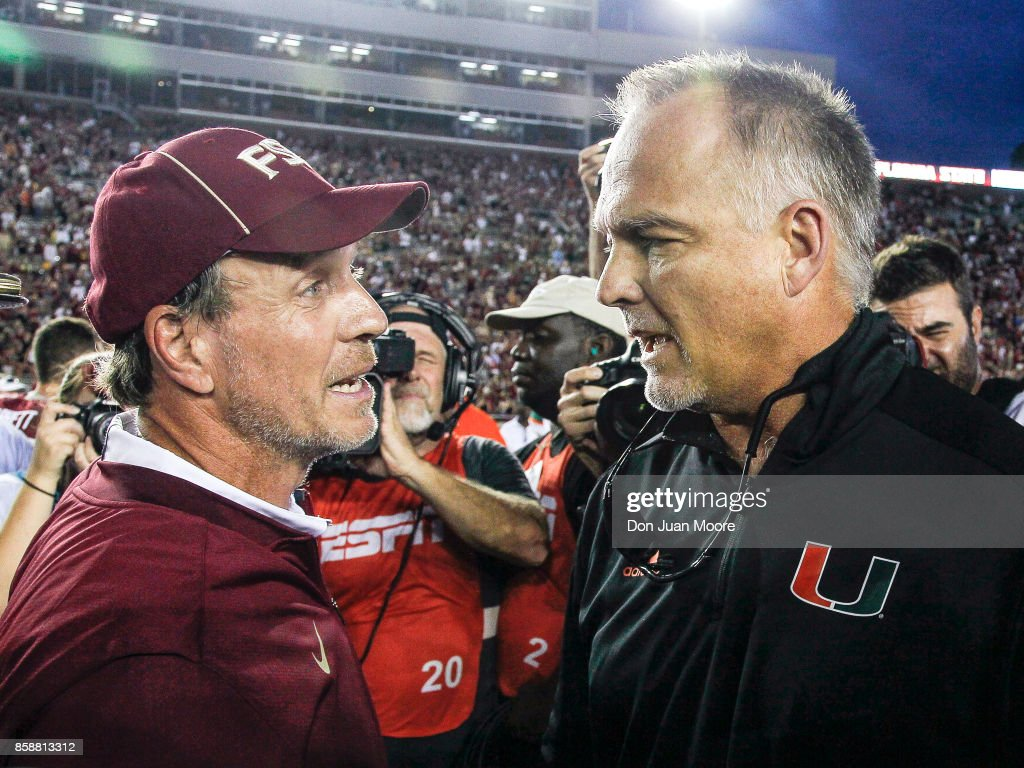 Head Coach Jimbo Fisher of the Florida State Seminoles talk with Head Coach Mark Richt of the Miami Hurricanes after the game at mid-field at Doak Campbell Stadium on Bobby Bowden Field on October 7, 2017 in Tallahassee, Florida. Miami defeated Florida State 24 to 20.