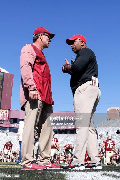 Head Coach Jimbo Fisher of the Florida State Seminoles talk with Head Coach Kenny Carter of the Delaware State Hornets at midfield before the game at...
