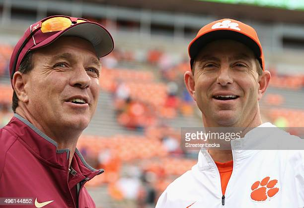 Head coach Jimbo Fisher of the Florida State Seminoles talks to head coach Dabo Swinney of the Clemson Tigers before their game at Memorial Stadium...