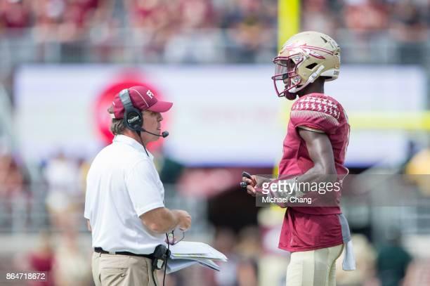 Head coach Jimbo Fisher of the Florida State Seminoles talks to quarterback James Blackman of the Florida State Seminoles at Doak Campbell Stadium on...