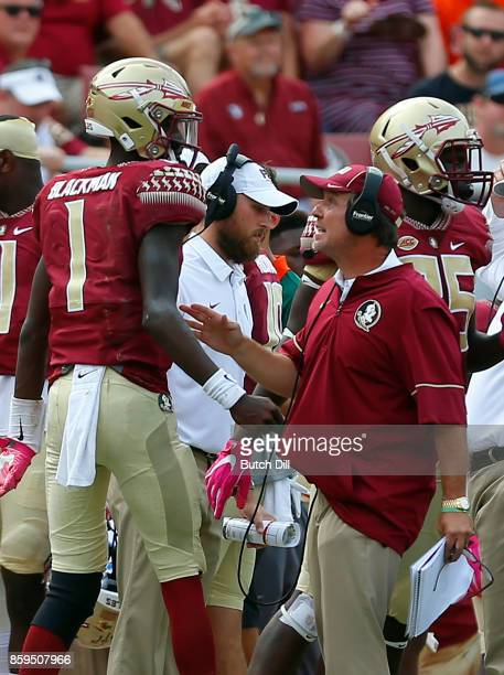 Head coach Jimbo Fisher talks with quarterback James Blackman of the Florida State Seminoles during the first half of an NCAA football game against...