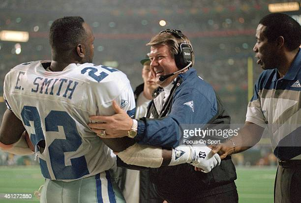 Head Coach Jimmy Johnson and Emmitt Smith of the Dallas Cowboys celebrates as the Cowboys leads the Buffalo Bills late in the fourth quarter of Super...