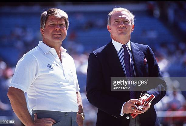 Head coach Jimmy Johnson and owner Jerry Jones of the Dallas Cowboys stand together prior to the start of a Cowboys game at Texas Stadium in Irving...