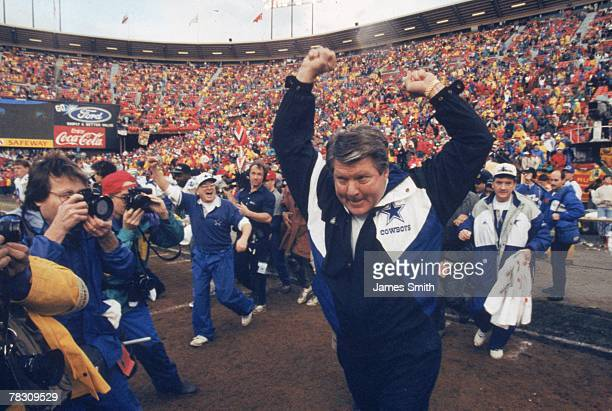 Head coach Jimmy Johnson of the Dallas Cowboys celebrates after a victory over the San Francisco 49ers in the 1992 NFC Championship Game at...