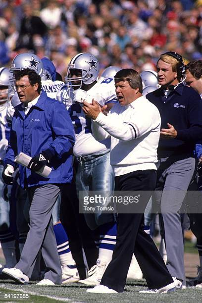 Head coach Jimmy Johnson of the Dallas Cowboys encourages his team from the sidelines during a game on October 8 1989 against the Green Bay Packers...