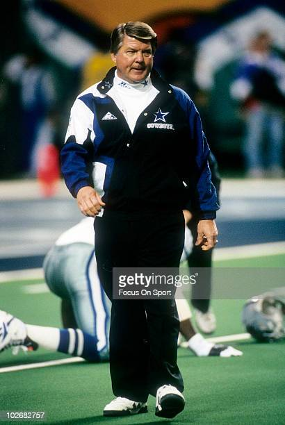 Head Coach Jimmy Johnson of the Dallas Cowboys in this portrait walking the field while his team stretches before Super Bowl XXVIII on January 30...