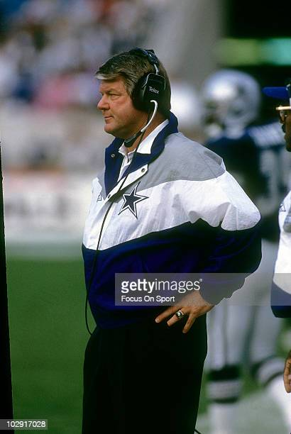 Head coach Jimmy Johnson of the Dallas Cowboys in this portrait watching the action from the sidelines circa 1992 during an NFL football game Johnson...