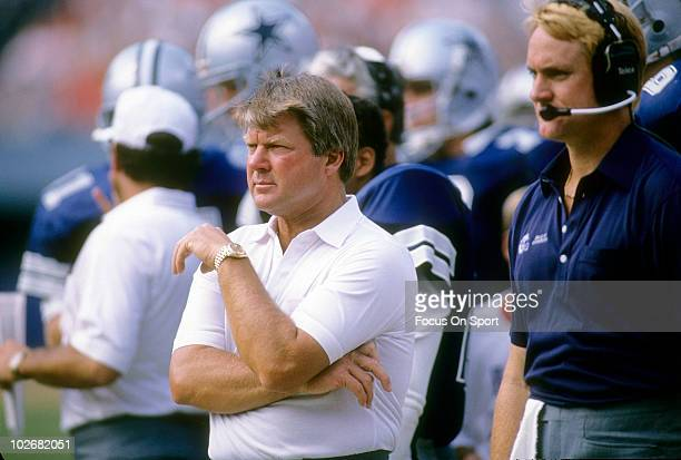 Head coach Jimmy Johnson of the Dallas Cowboys in this portrait with his arms folded watching the action from the sidelines circa 1989 during an NFL...