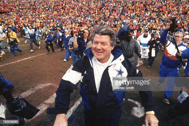 Head coach Jimmy Johnson of the Dallas Cowboys runs after the field after a victory against the San Francisco 49ers in the 1992 NFC Championship Game...