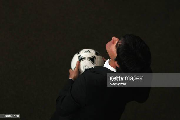 Head coach Joachim holds a ball during the DFB Euro 2012 squad announcement at Mercedes-Benz center on May 7, 2012 in Rastatt, Germany.