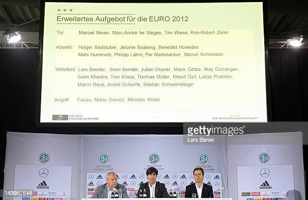 Head coach Joachim Loew adresses the media between press officer Harald Stenger and and team manager Oliver Bierhoff during the DFB Euro 2012 squad...