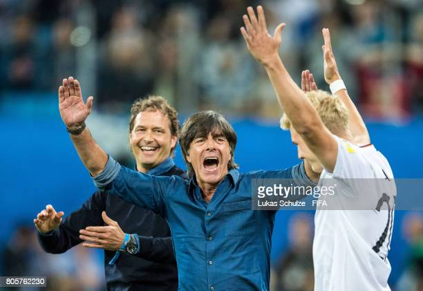 Head Coach Joachim Loew and Julian Brandt of Germany celebrate after winning the FIFA Confederations Cup final match between Chile and Germany at...