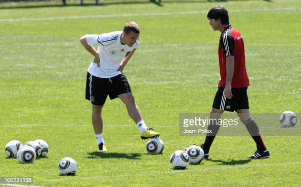 Head coach Joachim Loew and Lukas Podolski of Germany are seen during a training session at Sportzone Rungg on May 22, 2010 in Appiano sulla Strada...