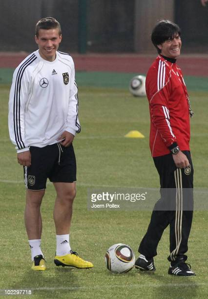 Head coach Joachim Loew and Lukas Podolski of Germany laugh during a training session at Super stadium on June 22 2010 in Pretoria South Africa