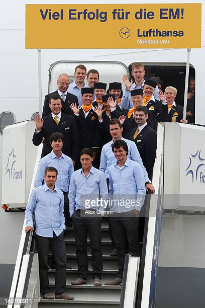Head coach Joachim Loew and players of the German national football team pose with the crew in front of the airplane prior to their departure to...