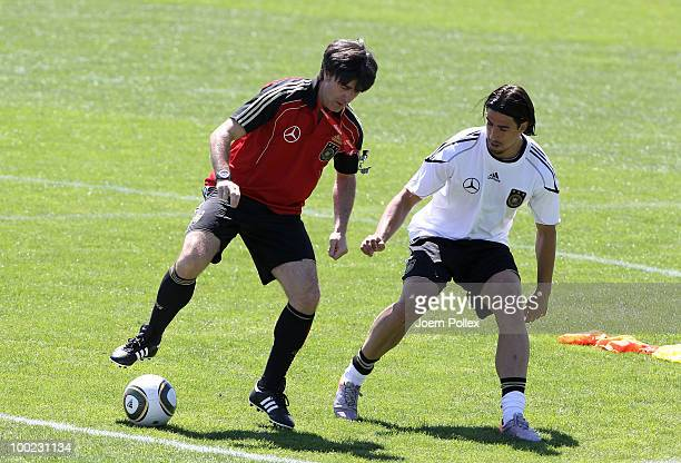 Head coach Joachim Loew and Sami Khedira of Germany are seen in action during a training session at Sportzone Rungg on May 22, 2010 in Appiano sulla...