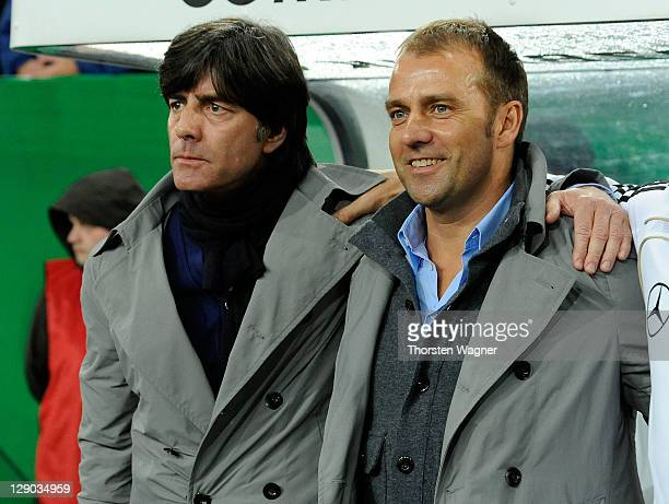 Head coach Joachim Loew and second coach Hansi Flick of Germany looks on prior to the Euro 2012 Qualifier Group A match between Germany and Belgium...