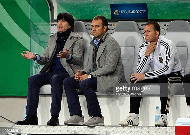 Head coach Joachim Loew and second coach Hansi Flick of Germany looks on during the Euro 2012 Qualifier Group A match between Germany and Belgium at...