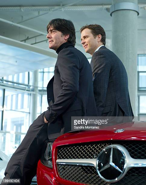 Head coach Joachim Loew and team manager Oliver Bierhoff of Germany pose after a DFB EURO 2012 press conference at Mercedes Benz World on February 22...