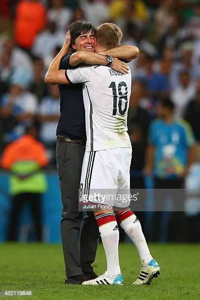 Head coach Joachim Loew and Toni Kroos of Germany celebrate after defeating Argentina 1-0 in extra time during the 2014 FIFA World Cup Brazil Final...