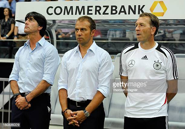 Head coach Joachim Loew assistant coach Hansi Flick goalkeeper Andreas Koepke look on prior to the international friendly match between Germany and...