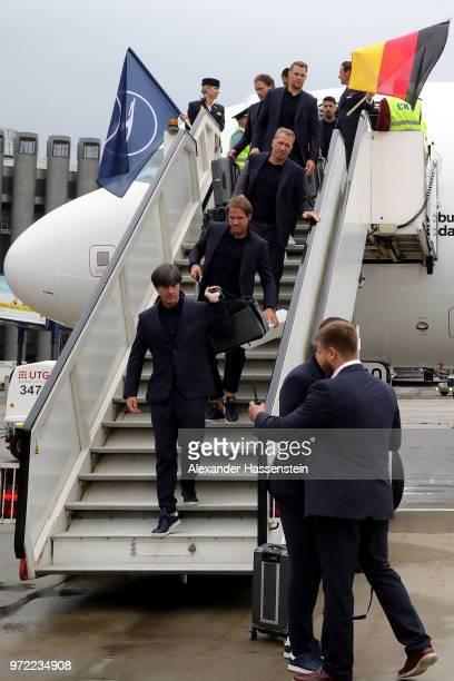 Head coach Joachim Loew assistant coach Thomas Schneider goalkeeping coach Andreas Koepke and goalkeeper Manuel Neuer walk down the gangway after...