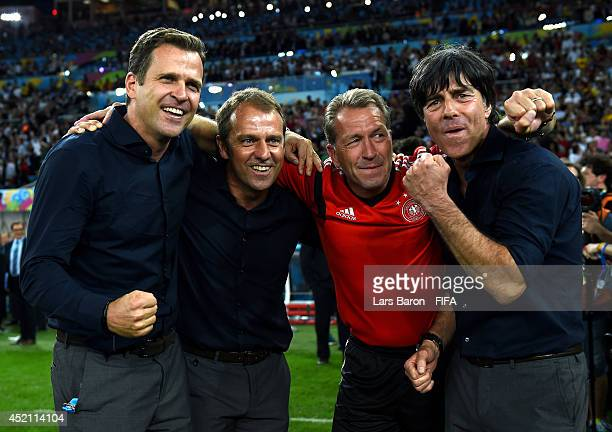 Head coach Joachim Loew celebrate winning the World Cup with team manager Oliver Bierhoff assistant coach Hansi Flick and goal keeper coach Andreas...