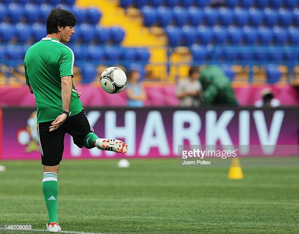 Head coach Joachim Loew controls the ball during a Germany training session ahead of their UEFA EURO 2012 Group B match against Netherlands at...