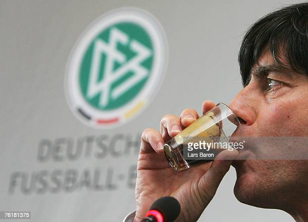 Head coach Joachim Loew drinks an espresso during the German National Football team press conference at DFB headquarters on August 20 2007 in...