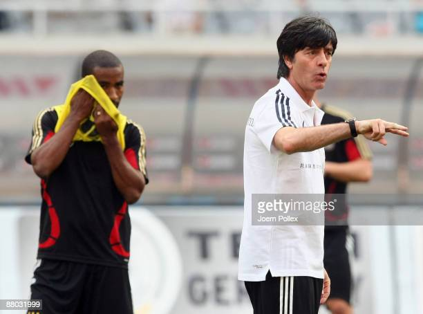 Head coach Joachim Loew gestures during a Germany training session at the Shanghai Stadium on May 28 2009 in Shanghai China