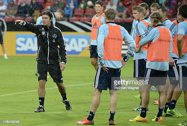 Head coach Joachim Loew gestures during the German National Football Team trainings session at Coface Arena on August 12 2013 in Mainz Germany The...