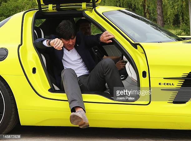 Head coach Joachim Loew gets out of a Mercedes SLS AMG ECell prior to a Germany press conference at the press center on June 7 2012 in Gdansk Poland