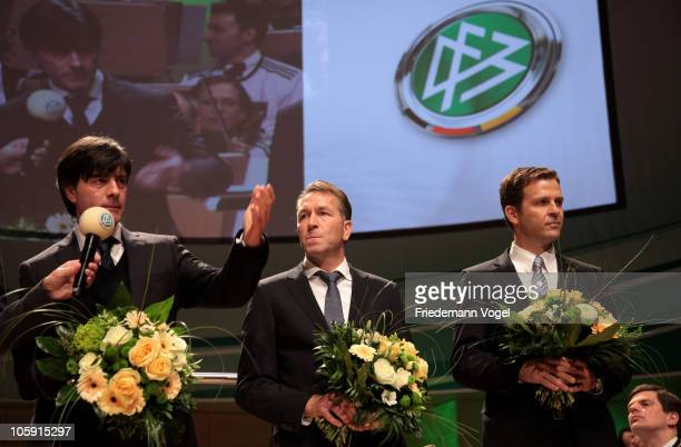 Head coach Joachim Loew goalkeeper coach Andreas Koepke and Manager Oliver Bierhoff of the German national football team are honored by Theo...