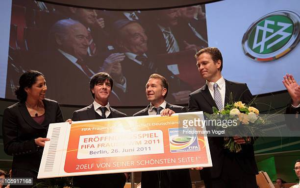 Head coach Joachim Loew goalkeeper coach Andreas Koepke and Manager Oliver Bierhoff of the German national football team get a ticket for the FIFA...