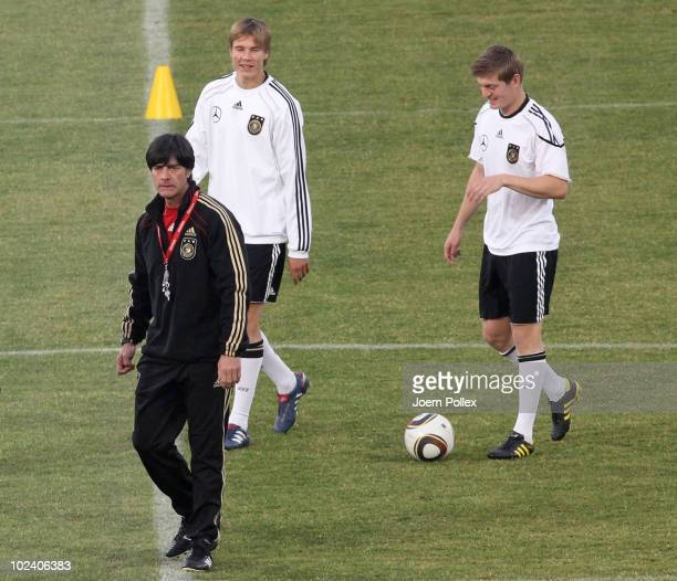 Head coach Joachim Loew Holger Badstuber and Toni Kroos of Germany walk on during a training session at Super stadium on June 25 2010 in Pretoria...