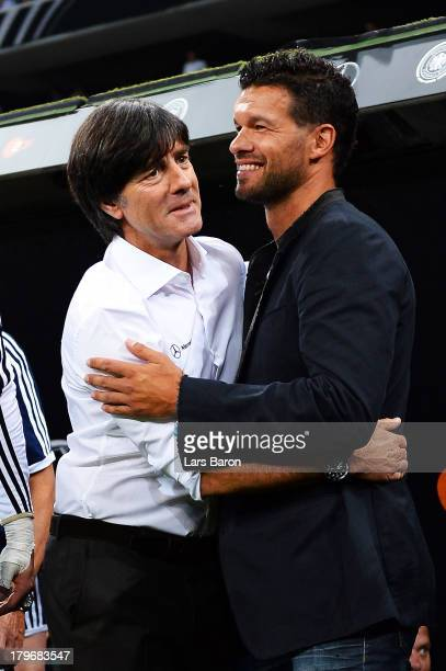 Head coach Joachim Loew hughs former player Michael Ballack during the FIFA 2014 World Cup Qualifying Group C match between Germany and Austria on...
