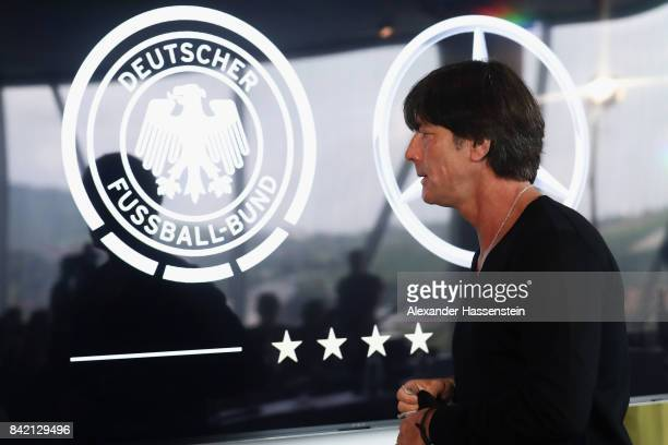 Head coach Joachim Loew leaves a Germany press conference at MercedesBenzMuseum ahead of their FIFA World Cup Russia 2018 Group C Qualifier against...