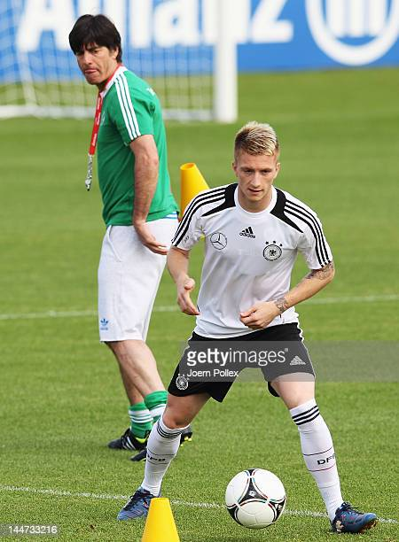 Head coach Joachim Loew looks at Marco Reus during a Germany training session at Stadium Tourette on May 18 2012 in TourrettessurLoup France