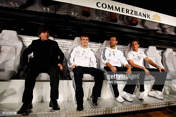 Head coach Joachim Loew Marko Marin Michael Ballack and Rene Adler pose on the new Commerzbank substitution bench during a press conference of the...