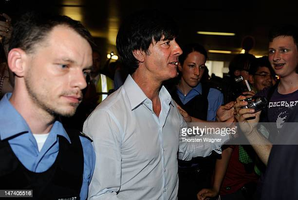 Head coach Joachim Loew of German National Football team looks on during the German National Team arrival at Franfurt Airport on June 29 2012 in...