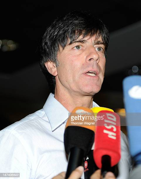 Head coach Joachim Loew of German National Football team talks to media during the German National Team arrival at Franfurt Airport on June 29 2012...