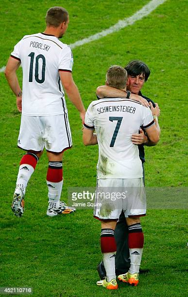 Head coach Joachim Loew of Germany and Bastian Schweinsteiger celebrate defeating Argentina 10 in the 2014 FIFA World Cup Brazil Final match between...