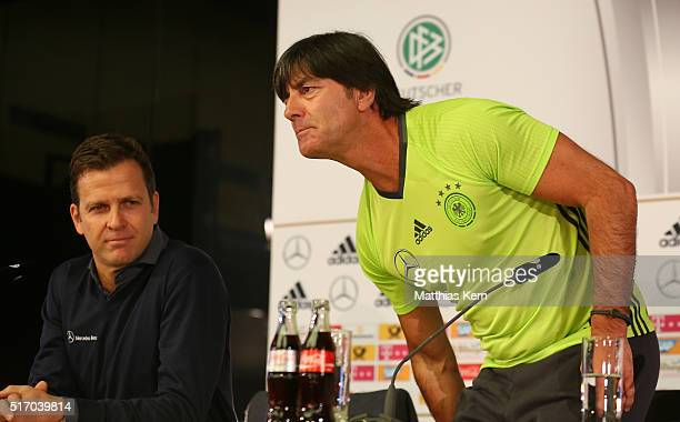 Head coach Joachim Loew of Germany and manager Oliver Bierhoff look on during a press conference ahead of their International friendly match against...