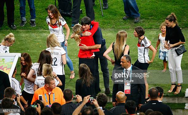 Head coach Joachim Loew of Germany celebrates with family and friends of the team during the 2014 FIFA World Cup Brazil Final match between Germany...