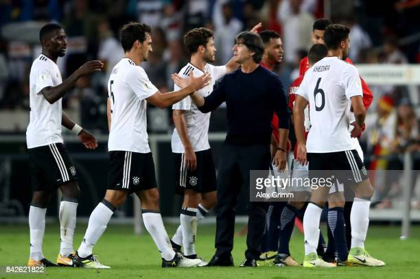 Head coach Joachim Loew of Germany celebrates with his players after winning the FIFA 2018 World Cup Qualifier between Germany and Norway at...